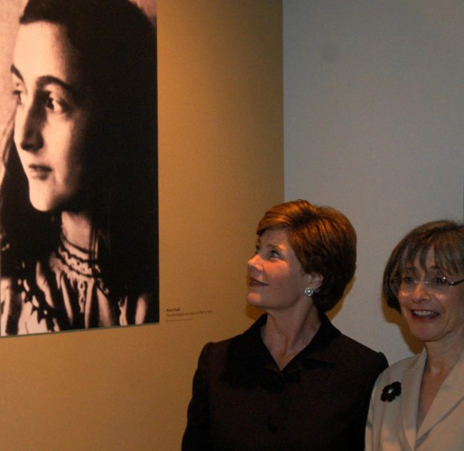 US First Lady Laura Bush looks at a photograph of Anne Frank with Sara Bloomfield (R), director of the United States Holocaust Museum, to honor the opening of the museum's exhibition of Anne Frank's original writings 11 June 2003 in Washington, DC. This is the first time her original writings have been on display outside the Netherlands. AFP PHOTO/NICHOLAS ROBERTS  (Photo credit should read NICHOLAS ROBERTS/AFP/Getty Images)