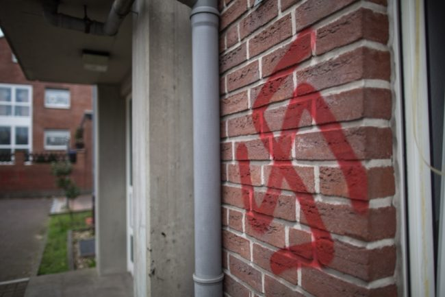 A swastika is sprayed at a asylum seeker accommodation in Waltrop, western Germany, on October 13, 2015. Four homes for asylum seekers in Waltrop were sprayed with swastikas during the night from October 12 to 13, 2015. AFP PHOTO / DPA / MAJA HITIJ  GERMANY OUT