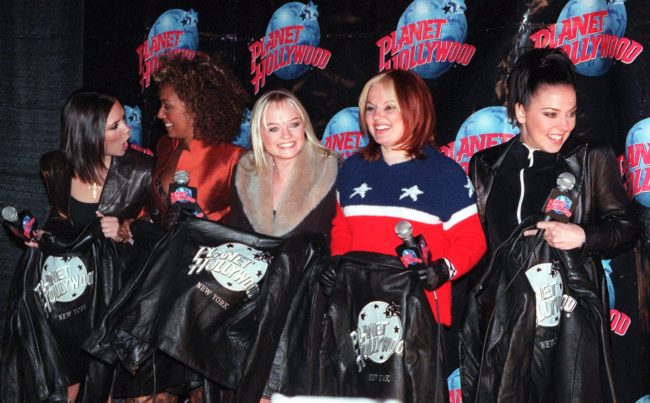 "NEW YORK, UNITED STATES: The Spice Girls' Posh Spice (Victoria Adams) (L) -- Scary Spice (Melanie Janine Brown) (2nd-L) -- Baby Spice (Emma Lee Burton) (C) -- Ginger Spice (Geraldine Halliwell) (2nd-R) -- and Sporty Spice (Melanie Jayne Chisolm) (R) -- pose for photographers with their Planet Hollywood jackets after they arrived for a screening of their new movie ""Spice World"" at Planet Hollywood in New York 14 January. AFP PHOTO Henny Ray ABRAMS (Photo credit should read HENNY RAY ABRAMS/AFP/Getty Images)"
