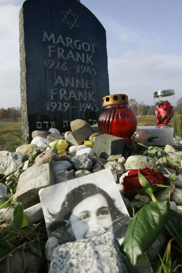 "The memorial stone for Jewish girl Anne Frank, author of ""The Diary of a Young Girl"", and her sister Margot is pictured 28 October 2007 on the grounds of the new Bergen-Belsen Memorial. Both girls died at the concentration camp a few weeks before it was liberated by British troops in April 1945. The Bergen-Belsen Memorial, which is situated sixty kilometres north-east of Hanover, is located on the grounds of the former Prisoner of War and concentration camps, marked graves and monuments hold reminders of the suffering and deaths of its prisoners. A documentation centre illustrates the history of the camp and its victims. AFP PHOTO DDP/NIGEL TREBLIN  GERMANY OUT (Photo credit should read NIGEL TREBLIN/AFP/Getty Images)"