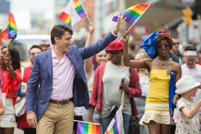 Prime Minister Justin Trudeau waves to the crowd as he marches in the Pride Parade in Toronto, June 25, 2017. / AFP PHOTO / GEOFF ROBINS (Photo credit should read GEOFF ROBINS/AFP/Getty Images)