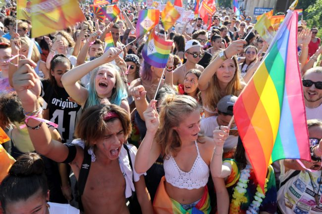 People take part in the Pink Parade; the Lesbian, Gay, Bisexual and Transgender (LGBT) Pride celebration in Nice, southeastern France, on August 5, 2017.   / AFP PHOTO / VALERY HACHE        (Photo credit should read VALERY HACHE/AFP/Getty Images)