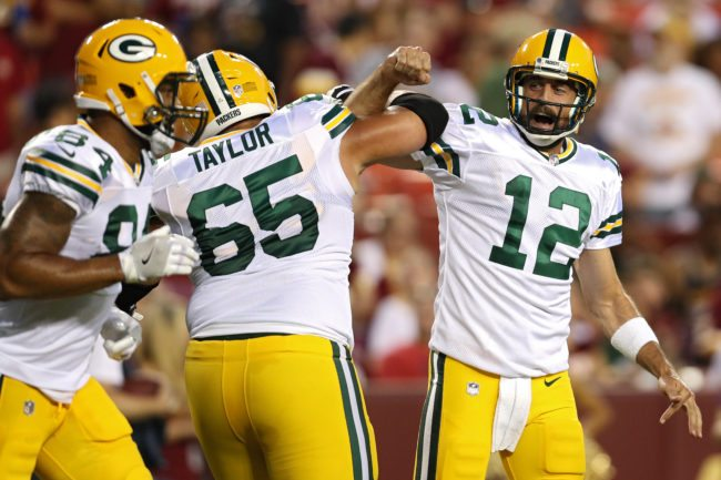 LANDOVER, MD - AUGUST 19: Quarterback Aaron Rodgers #12 of the Green Bay Packers celebrates a touchdown pass with teammate Lane Taylor #65 against the Washington Redskins in the first half during a preseason game at FedExField on August 19, 2017 in Landover, Maryland. (Photo by Patrick Smith/Getty Images)