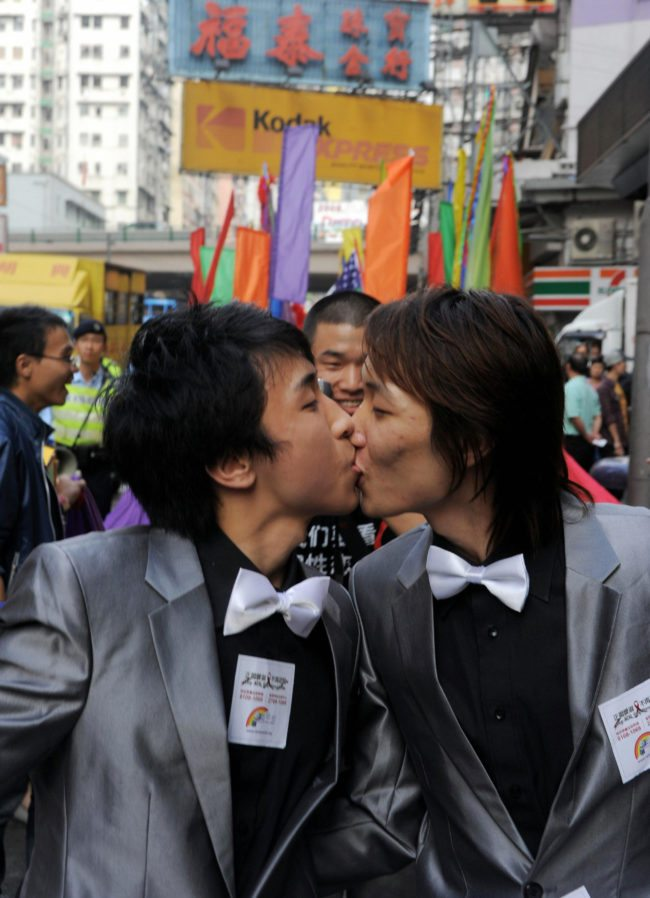 Rally participants take part in a gay and lesbian rally through the streets in Hong Kong on December 13, 2008. Hundreds marched to promote the rights of the gay and lesbian community in the territory. AFP PHOTO/CHEUNG KA CHUN (Photo credit should read CHEUNG KA CHUN/AFP/Getty Images)
