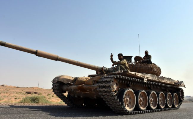 Syrian Government fighters on a tank