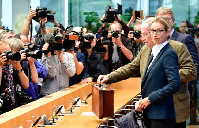 Joerg Meuthen (R, hidden), co-leader of Germany's nationalist Alternative for Germany (AfD) party, AfD top candidate Alexander Gauland (3rd R) and AfD top candidate Alice Weidel (2nd R) arrive for a press conference of the AfD in Berlin on September 25, 2017, one day after general elections. Frauke Petry, co-chief of the nationalist Alternative for Germany party, declared she would not join her party's parliamentary group amid a bitter dispute with more hardline colleagues. / AFP PHOTO / Tobias SCHWARZ (Photo credit should read TOBIAS SCHWARZ/AFP/Getty Images)