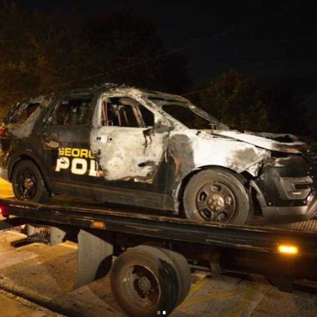 The burnt shell of the police car