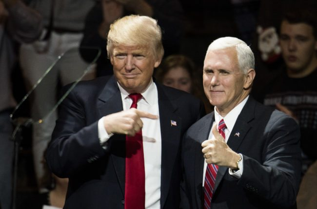 CINCINNATI, OH - DECEMBER 01: President-elect Donald Trump and Vice President-elect Mike Pence stand onstage together at U.S. Bank Arena on December 1, 2016 in Cincinnati, Ohio. Trump took time off from selecting the cabinet for his incoming administration to celebrate his victory in the general election. (Photo by Ty Wright/Getty Images)