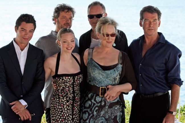 "(From L to R) British actor Dominic Cooper, British actor Colin Firth, US actress Amanda Seyfried, Swedish actor Stellan Skarsgard, US actress Meryl Streep and Irish actor Pierce Brosnan pose during a photo opportunity for the promotion of the new movie ""Mamma Mia"" at the Lagonissi Grand Resort, some 40 kms south of Athens on June 28, 2008.      AFP PHOTO / Aris Messinis        (Photo credit should read ARIS MESSINIS/AFP/GettyImages)"