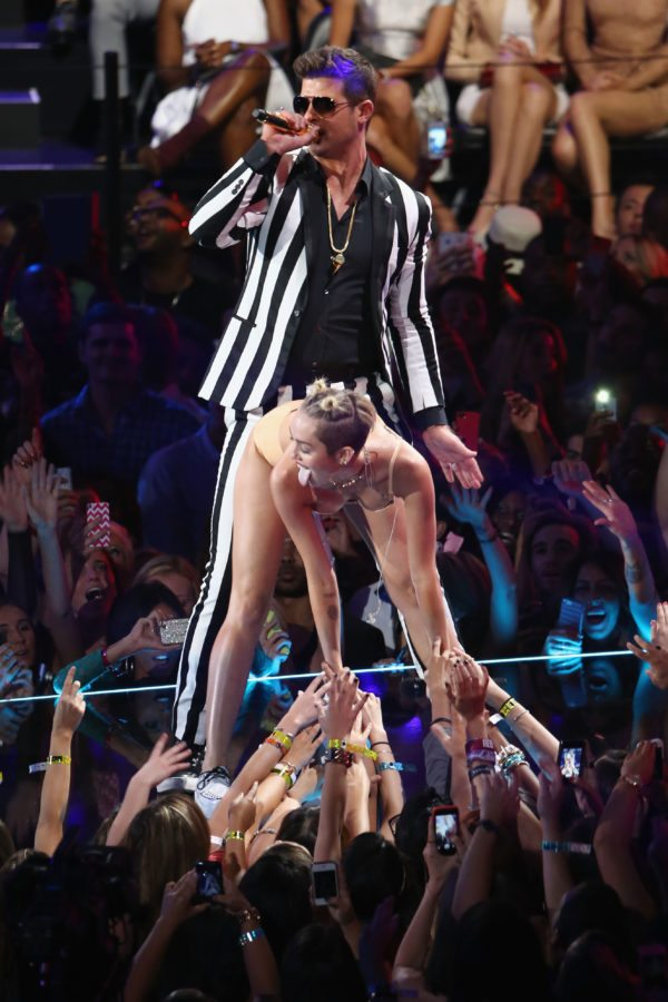 NEW YORK, NY - AUGUST 25:  Miley Cyrus and Robin Thicke perform onstage during the 2013 MTV Video Music Awards at the Barclays Center on August 25, 2013 in the Brooklyn borough of New York City.  (Photo by Neilson Barnard/Getty Images for MTV)