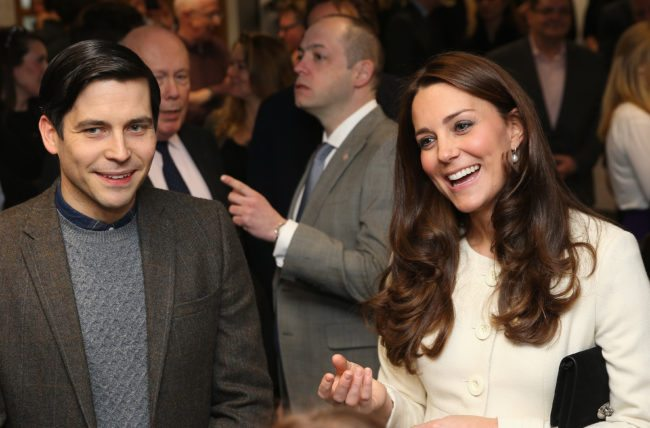 LONDON, ENGLAND - MARCH 12:  Catherine, Duchess of Cambridge shares a joke with actor Robert James-Collier (Thomas) during an official visit to the set of Downton Abbey at Ealing Studios on March 12, 2015 in London, England.  (Photo by Chris Jackson - WPA Pool/Getty Images)
