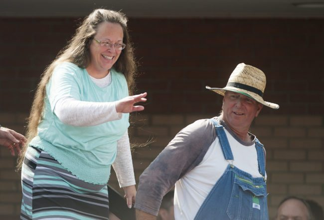 GRAYSON, KY - SEPTEMBER 8: Rowan County Clerk of Courts Kim Davis (L) walks off stage with her husband Joe Davis (R) in front of the Carter County Detention Center on September 8, 2015 in Grayson, Kentucky. Davis was ordered to jail last week for contempt of court after refusing a court order to issue marriage licenses to same-sex couples. (Photo by Ty Wright/Getty Images)