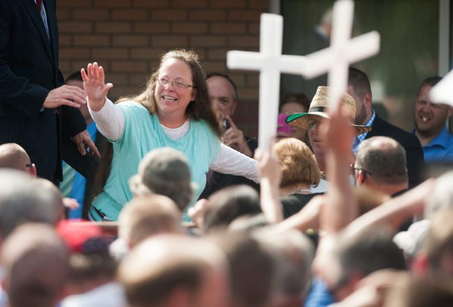 GRAYSON, KY - SEPTEMBER 8: Rowan County Clerk of Courts Kim Davis waves to a crowd of her supporters at a rally in front of the Carter County Detention Center on September 8, 2015 in Grayson, Kentucky. Davis was ordered to jail last week for contempt of court after refusing a court order to issue marriage licenses to same-sex couples. (Photo by Ty Wright/Getty Images)