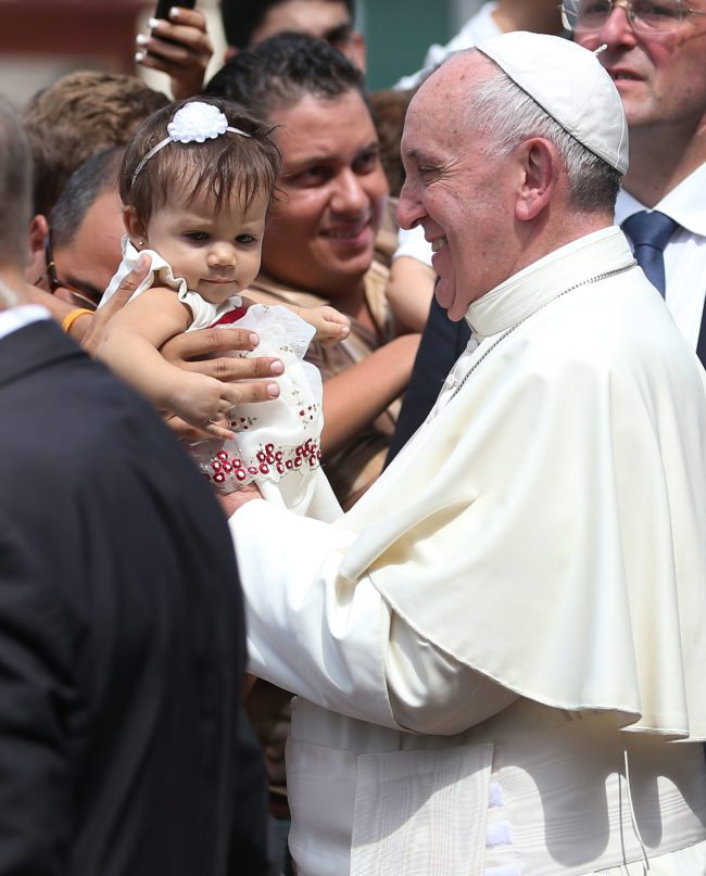 SANTIAGO DE CUBA, CUBA - SEPTEMBER 22:  Pope Francis holds a baby as he leaves the cathedral after holding a mass and blessing the city on September 22, 2015 in Santiago de Cuba, Cuba. Pope Francis leaves for the United States after spending four days in Cuba.  (Photo by Joe Raedle/Getty Images)