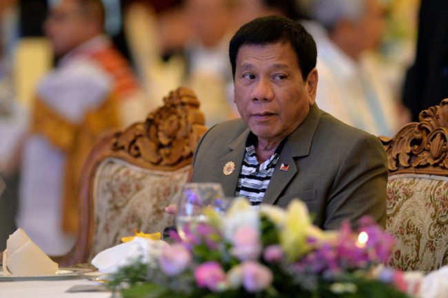 Philippine President Rodrigo Duterte (C) attends a welcome dinner at the ASEAN Summit in Vientiane on September 6, 2016. The gathering will see the 10 ASEAN members meet by themselves, then with leaders from the US, Japan, South Korea and China.  / AFP PHOTO / YE AUNG THU        (Photo credit should read YE AUNG THU/AFP/Getty Images)