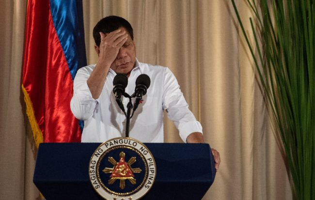 Philippine President Rodrigo Duterte gestures as he gives a speech during the mass oath taking of officials of various national leagues at the Malacanang Palace in Manila on June 1, 2017. Philippine airstrikes aimed at Islamist militants who are holding hostages as human shields in a southern city killed 11 soldiers, authorities said on June 1, as they conceded hundreds of gunmen may have escaped a blockade. / AFP PHOTO / NOEL CELIS (Photo credit should read NOEL CELIS/AFP/Getty Images)