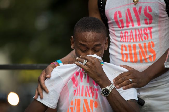 NEW YORK, NY - JUNE 12:  Keion Carter, survivor of the 2016 Pulse nightclub shooting, breaks down while speaking the audience during a memorial service and rally for the victims of the 2016 Pulse nightclub shooting, down the street from the historic Stonewall Inn June 12, 2017 in New York City. Monday marks the one year anniversary of the Pulse nightclub shooting in Orlando, Florida that killed 49 people. (Photo by Drew Angerer/Getty Images)