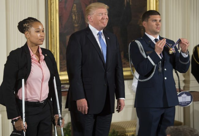 US President Donald Trump presents the Medal of Valor to US Capitol Police Officer Crystal Griner during a ceremony honoring the first responders of the June 14 shooting against members of the Republican Congressional Baseball team, where US House Majority Whip Representative Steve Scalise, Republican of Louisiana, was shot, in the East Room of the White House in Washington, DC, July 27, 2017. / AFP PHOTO / SAUL LOEB        (Photo credit should read SAUL LOEB/AFP/Getty Images)