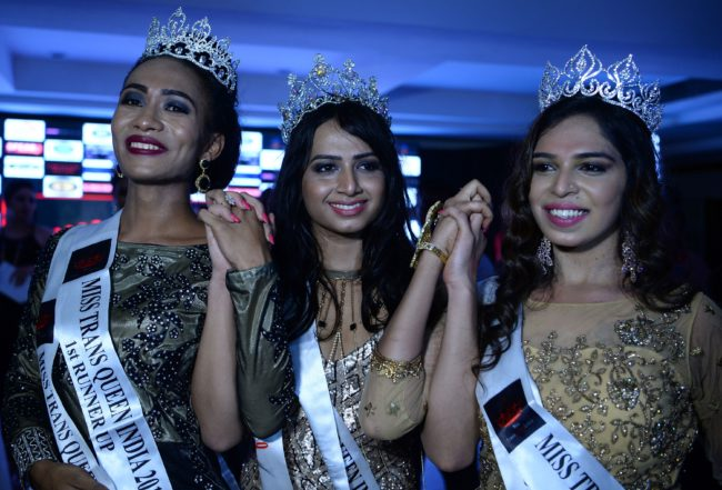 In this photograph taken on August 27, 2017, Miss Transqueen 2017 winner Nitasha (C) poses with runners-up Loiloi (L) and Ragasya (R) at a beauty pageant for transgender people in Gurgaon near the Indian capital New Delhi. The top three winners of the Miss Transqueen India 2017 contest will represent India at the Miss International Queen contest in Thailand in 2018. / AFP PHOTO / SAJJAD HUSSAIN        (Photo credit should read SAJJAD HUSSAIN/AFP/Getty Images)