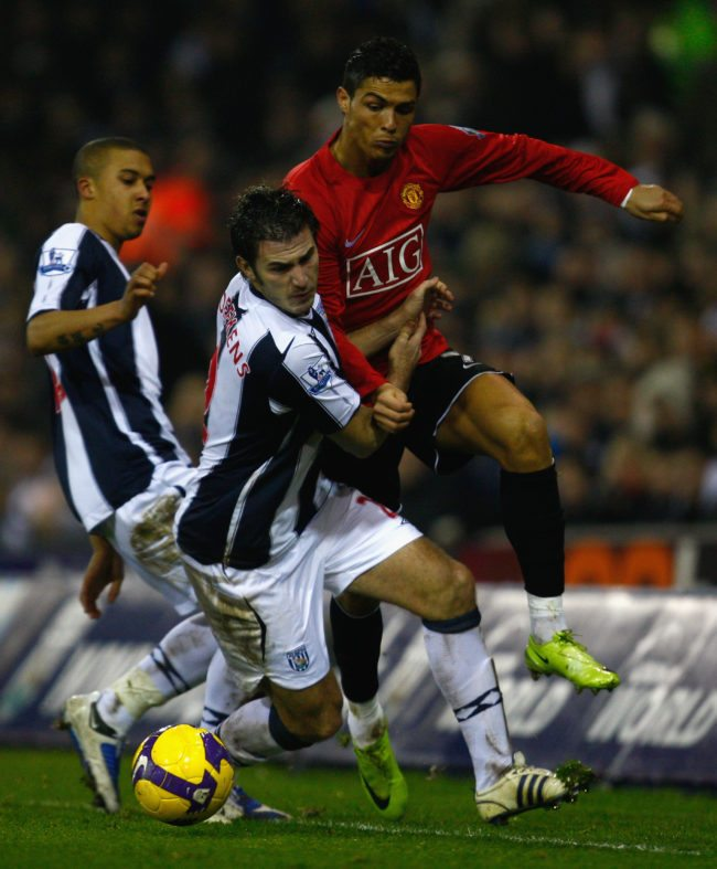 WEST BROMWICH, UNITED KINGDOM -JANUARY 27:   Carl Hoefkens of West Bromwich Albion battles for the ball with Cristiano Ronaldo of Manchester United during the Barclays Premier League match between West Bromwich Albion and Manchester United at The Hawthorns on January 27, 2009 in West Bromwich, England.  (Photo by Mark Thompson/Getty Images)