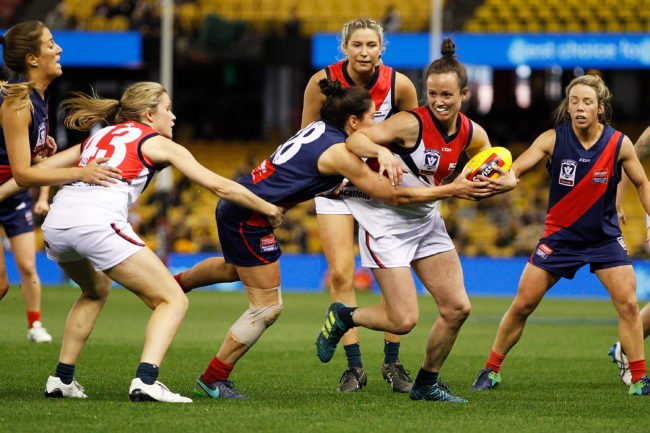 MELBOURNE, AUSTRALIA - SEPTEMBER 24:  Daisy Pearce of Darebin is tackled by Shae Audley of Diamond Creek during the VFL Women's Grand Final match between Diamond Creek and Darebin at Etihad Stadium on September 24, 2017 in Melbourne, Australia.  (Photo by Daniel Pockett/AFL Media/Getty Images)