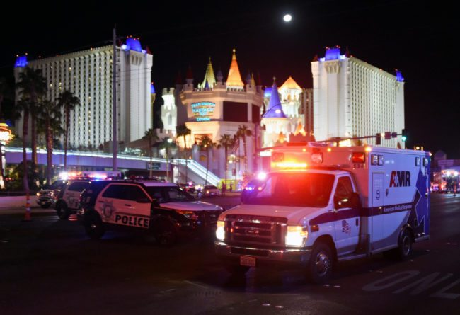 LAS VEGAS, NV - OCTOBER 02:  An ambulance leaves the intersection of Las Vegas Boulevard and Tropicana Ave. after a mass shooting at a country music festival nearby on October 2, 2017 in Las Vegas, Nevada. A gunman has opened fire on a music festival in Las Vegas, leaving at least 20 people dead and more than 100 injured. Police have confirmed that one suspect has been shot. The investigation is ongoing. (Photo by Ethan Miller/Getty Images)