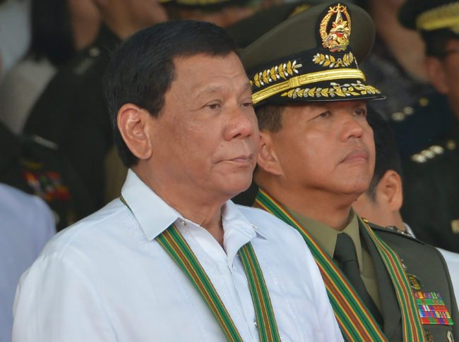 Philippine President Rodrigo Duterte (L) stands next to newly-installed army commanding general Major General Rolando Bautista (R) during the turn-over ceremony of the army commanding general at Fort Bonifacio in Manila on October 5, 2017. Newly installed army commanding general Major General Rolando Bautista said in his speech the army hopes to end the war in Marawi at the end of October. / AFP PHOTO / TED ALJIBE (Photo credit should read TED ALJIBE/AFP/Getty Images)