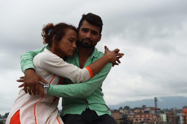 This photo taken on August 3, 2017 shows Nepali transgender person Monika Shahi Nath and her husband Ramesh Nath Yogi posing for a picture in Kathmandu. Monika Shahi Nath, 40, became Nepal's first transgender person to be issued with a marriage certificate by district officials when she married 22-year-old Ramesh Nath Yogi in May, even though Nepal has no formal laws for such unions. The couple have found a rare acceptance in Nepal, where many transgender people still struggle to be open about their identity despite progressive laws that include a third gender option on identity cards and passports. / AFP PHOTO / Prakash MATHEMA / TO GO WITH Nepal-transgender-marriage-rights        (Photo credit should read PRAKASH MATHEMA/AFP/Getty Images)
