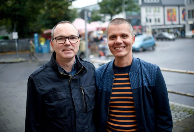 German couple Michael (L) and Kai Korok pose on October 10, 2017 in Berlin, after they became the first same-sex couple to adopt a child in Germany, only ten days after Germany allowed same-sex couples to wed from October 1.   Berliners Michael and Kai Korok promptly transformed their civil partnership into marriage on October 2, and two days later, they submitted their wedding certificate to seek legal adoption of a two-year-old boy who has lived with them as a foster child since birth.  / AFP PHOTO / dpa / Britta Pedersen / Germany OUT        (Photo credit should read BRITTA PEDERSEN/AFP/Getty Images)