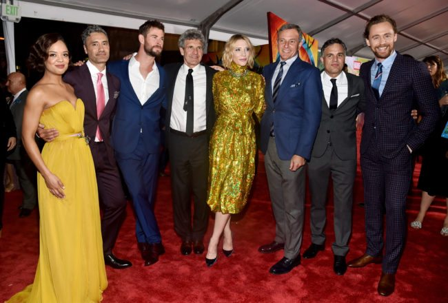 "HOLLYWOOD, CA - OCTOBER 10:  (L-R) Actor Tessa Thompson, Director Taika Waititi, Actor Chris Hemsworth, Chairman, The Walt Disney Studios, Alan Horn, Actor Cate Blanchett, The Walt Disney Company Chairman and CEO, Bob Iger, Actors Mark Ruffalo and Tom Hiddleston at The World Premiere of Marvel Studios' ""Thor: Ragnarok"" at the El Capitan Theatre on October 10, 2017 in Hollywood, California.  (Photo by Alberto E. Rodriguez/Getty Images for Disney)"