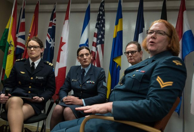 Major Alexandra Larsson of the Swedish Armed Forces, Sergeant Lucy Jordan of the New Zealand Air Force and Major Donna Harding of the Royal Australian Army Nursing Corps listen to Corporal Natalie Murray of the Canadian Forces