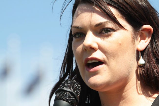 CANBERRA, AUSTRALIA - SEPTEMBER 28:  Australian Green's Senator Sarah Hanson-Young addresses the crowd during a Free the Refugees rally on opening day of Australia's 43rd parliament at Parliament House September 28, 2010 in Canberra, Australia. The opening comes five weeks after the federal election resulted in a hung parliament and left the country waiting while Independent MPs deliberated to ultimately form a minority government.  (Photo by Cole Bennetts/Getty Images)