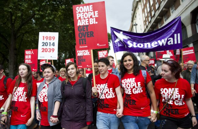 Members of the Lesbian, Gay, Bisexual and Transgender (LGBT) take part in the annual Pride Parade in London on June 28, 2014. AFP PHOTO/JUSTIN TALLIS (Photo credit should read JUSTIN TALLIS/AFP/Getty Images)