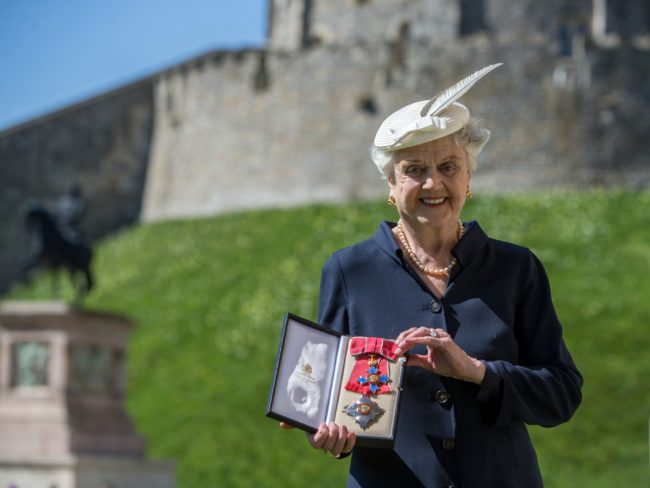 WINDSOR, ENGLAND - APRIL 15:  Actress Angela Lansbury poses with her Dame Commander (DBE) medal given to her by Queen Elizabeth II at an Investiture ceremony at Windsor Castle on April 15, 2014 in Berkshire, England.  (Photo by Steve Parsons - WPA Pool/Getty Images)