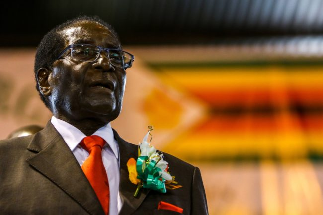 Zimbabwe President Robert Mugabe attends a meeting with the Zimbabwe National Liberation War Veterans Associatioin on April 7, 2016 in Harare. / AFP PHOTO / JEKESAI NJIKIZANA        (Photo credit should read JEKESAI NJIKIZANA/AFP/Getty Images)