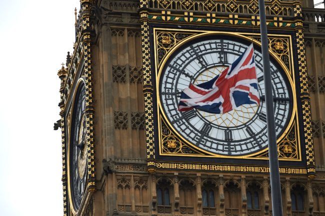 A Union flags flies at half mast over Portcullis House in front of the clock face of Queen Elizabeth Tower (Big Ben) at the Houses of Parliament in honour of slain Labour MP Jo Cox in London on June 20, 2016. British lawmakers gathered Monday to honour a murdered colleague, attempting a rare show of unity in a heated, neck-and-neck race for votes three days before a referendum on whether to quit the EU.  / AFP / Niklas HALLE'N        (Photo credit should read NIKLAS HALLE'N/AFP/Getty Images)