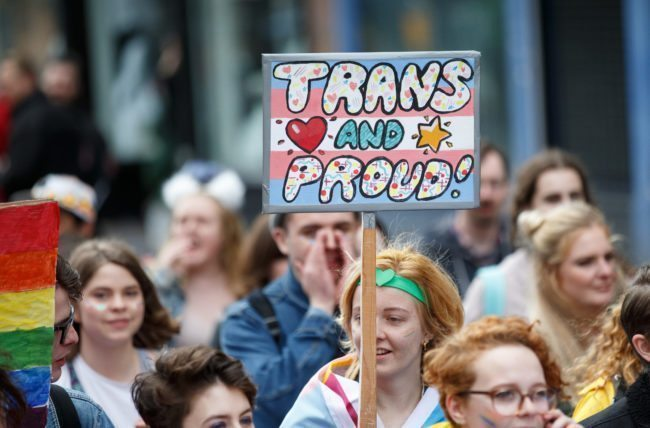 "GLASGOW, SCOTLAND - AUGUST 19: A participant holds a sign saying ""Trans and Proud"" during the Glasgow Pride march on August 19, 2017 in Glasgow, Scotland. The largest festival of LGBTI celebration in Scotland has been held every year in Glasgow since 1996. (Photo by Robert Perry/Getty Images)"