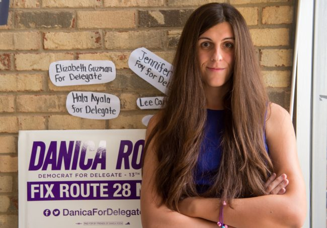 "Danica Roem, a Democrat for Delegate in Virginia's district 13, and who is transgender, sits in her campaign office on September 22, 2017, in Manassas, Virginia. ""Look at the inside of my shoe, ok?"" replies Danica Roem when asked how many voters she has already approached in her bid to win a Virginia statehouse seat.The Democratic candidate has no time for subtleties as she races to become the first openly transgender person elected to office in this Republican US state. Whether spitting in the trashcan during a recent interview with Cosmopolitan magazine or whipping off her ballerina flat to show its worn insole to AFP, this young woman does not shy from flaunting her working-class roots. / AFP PHOTO / Paul J. RICHARDS / TO GO WITH AFP STORY -""Transgender metalhead makes historic political office bid"" (Photo credit should read PAUL J. RICHARDS/AFP/Getty Images)"