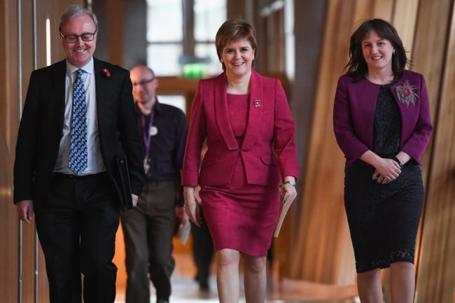 EDINBURGH, SCOTLAND - NOVEMBER 07: First Minister Nicola Sturgeon arrives at the Scottish Parliament,where she gave a formal apology to gay men on November 7, 2017 in Edinburgh, Scotland. The statement coincided with a new legislation that will automatically pardon gay and bisexual men convicted under historical laws. (Photo by Jeff J Mitchell/Getty Images)