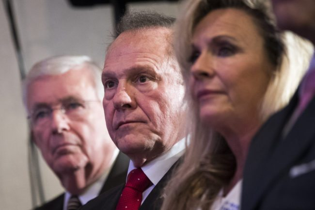 BIRMINGHAM, AL - NOVEMBER 16: Republican candidate for U.S. Senate Judge Roy Moore, sitting next to his wife Kayla Moore, waits to speak at a news conference with supporters and faith leaders, November 16, 2017 in Birmingham, Alabama. Moore refused to answer questions regarding sexual harassment allegations and pursuing relationships with underage women. (Drew Angerer/Getty Images)