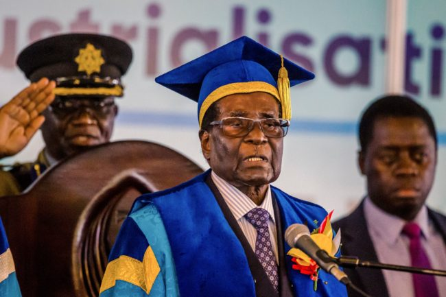 Zimbabwe's President Robert Mugabe delivers a speech during a graduation ceremony at the Zimbabwe Open University in Harare, where he presides as the Chancellor on November 17 2017.  Zimbabwean President Robert Mugabe attended a university graduation ceremony today, making a defiant first public appearance since the military takeover that appeared to signal the end of his 37-year reign. / AFP PHOTO / -        (Photo credit should read -/AFP/Getty Images)