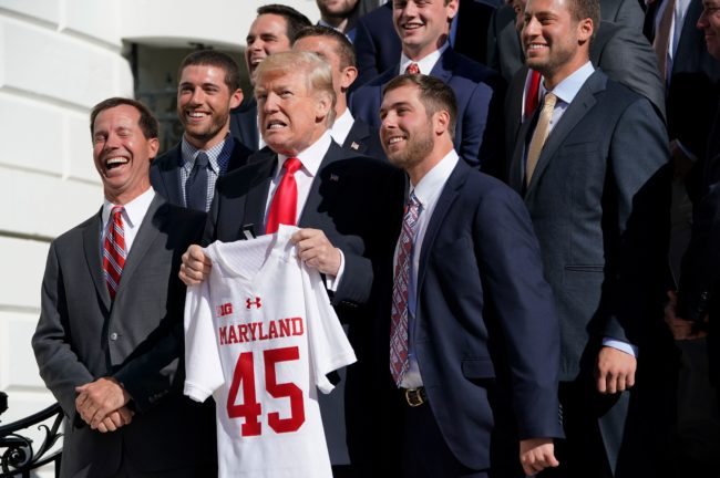 US President Donald Trump poses with members of the University of Maryland lacrosse team during an event honoring NCAA national championship teams on November 17, 2017 in Washington, DC. / AFP PHOTO / Mandel NGAN (Photo credit should read MANDEL NGAN/AFP/Getty Images)