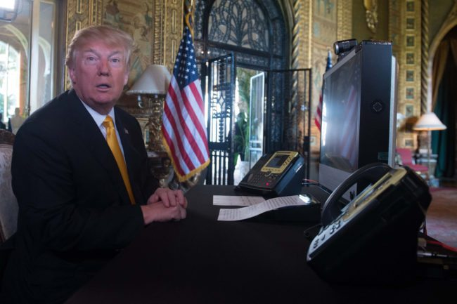 US President Donald Trump prepares his traditionnal adress to thank members of the US military via video teleconference on Thanksgiving day, November 23, 2017 from his residence in Mar-a-Lago in Florida. The US President is spending the Thanksgiving holidays in his Florida private residence until November 26. / AFP PHOTO / Nicholas KAMM (Photo credit should read NICHOLAS KAMM/AFP/Getty Images)