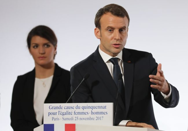 French President Emmanuel Macron (R) stands next to French Junior Minister for Gender Equality Marlene Schiappa as he delivers a speech during the International Day for the Elimination of Violence Against Women, on November 25, 2017 at the Elysee Palace in Paris. / AFP PHOTO / POOL / ludovic MARIN        (Photo credit should read LUDOVIC MARIN/AFP/Getty Images)