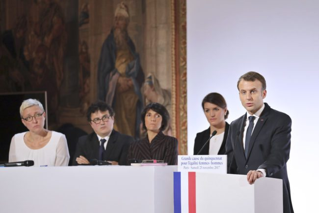 """(From L) President of the association Femmes Solidaires Sabine Salmon, French emergency doctor and writer Patrick Pelloux, French humorist and patron of the association """"Women Safe"""" Florence Foresti and French Junior Minister for Gender Equality Marlene Schiappa and French President Emmanuel Macron (R) attend the International Day for the Elimination of Violence Against Women, on November 25, 2017 at the Elysee Palace in Paris. / AFP PHOTO / POOL / ludovic MARIN        (Photo credit should read LUDOVIC MARIN/AFP/Getty Images)"""