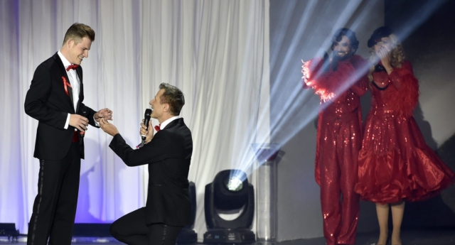 A gay couple get engaged as Conchita Wurst looks on (Photo by HANS PUNZ/AFP/Getty Images)