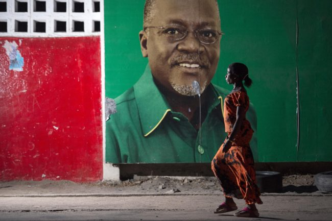 A woman walks past an election billboard after ruling party Chama Cha Mapinduzi (CCM) candidate John Magufuli (pictured on the billboard) was named president-elect by the National Electoral Commission in Dar es Salaam, on October 29, 2015. Opposition party Chadema presidential candidate Edward Lowassa has rejected the election results and has filed an official petition against the National Electoral Commission. The win by Magufuli with over 58 percent of votes cements the long-running Chama Cha Mapinduzi (CCM) party's firm grip on power, ruling Tanzania since 1977 when two independence-era parties merged. AFP PHOTO / DANIEL HAYDUK (Photo credit should read Daniel Hayduk/AFP/Getty Images)