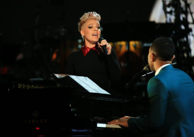 """LOS ANGELES, CA - NOVEMBER 18:  Recording artists P!nk (L) and John Legend perform onstage at A+E Networks """"Shining A Light"""" concert at The Shrine Auditorium on November 18, 2015 in Los Angeles, California.  (Photo by Christopher Polk/Getty Images for A+E Networks)"""