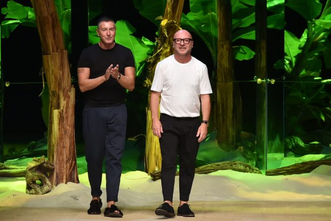 Designers Domenico Dolce (R) and Stefano Gabbana greet the audience at the end of the show for fashion house Dolce Gabbana during the 2017 Women's Spring / Summer collections shows at Milan Fashion Week on September 25, 2016 in Milan. / AFP / ALBERTO PIZZOLI (Photo credit should read ALBERTO PIZZOLI/AFP/Getty Images)