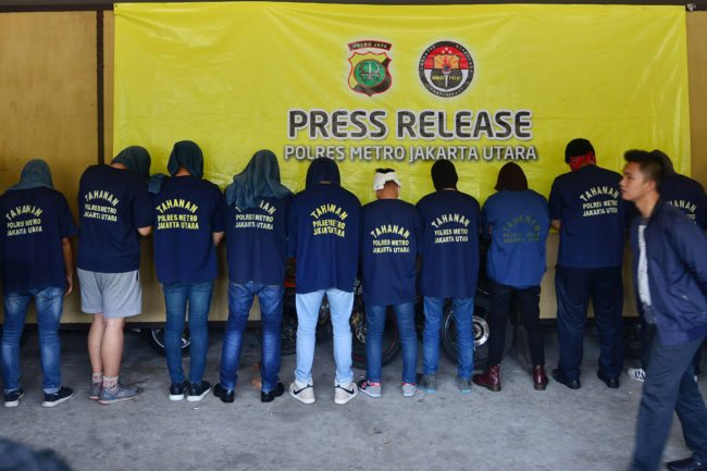 Men arrested in a recent raid stand in line during a press conference at a police station in Jakarta on May 22, 2017.  Indonesian police have detained 141 men who were allegedly holding a gay party at a sauna, an official said on May 22, the latest sign of a backlash against homosexuals in the Muslim-majority country. / AFP PHOTO / FERNANDO        (Photo credit should read FERNANDO/AFP/Getty Images)